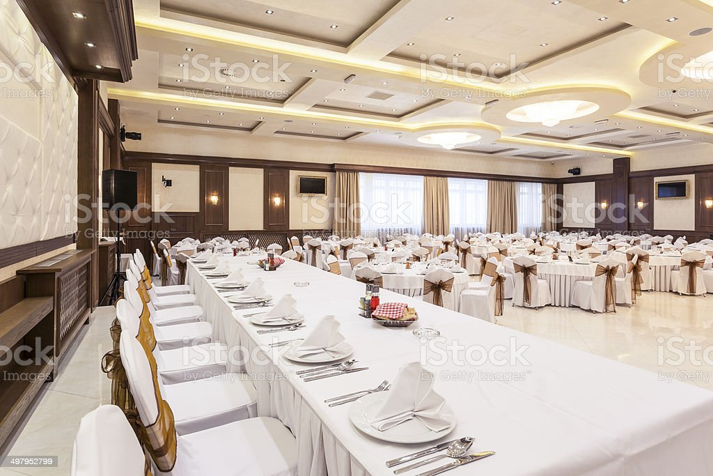 Head table at banquet hall stock photo