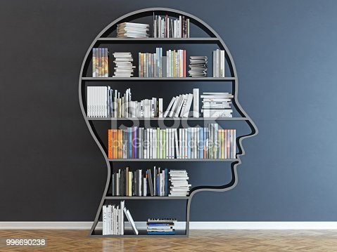 istock Head with a bookshelf in front of black wall 996690238