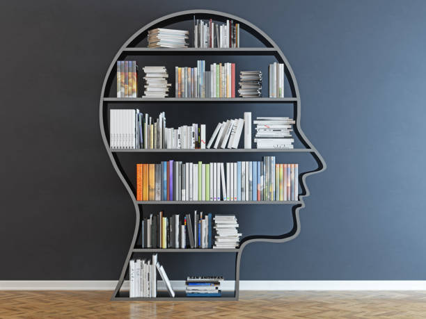 Head with a bookshelf in front of black wall Head with a bookshelf in front of black wall wisdom stock pictures, royalty-free photos & images