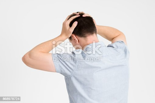 istock Headache and migraine, man with head pain on gray background 868978724