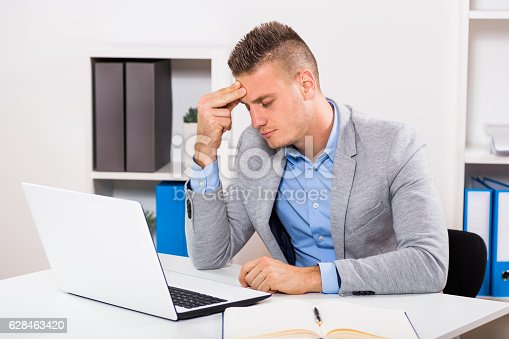 istock Headache at work 628463420