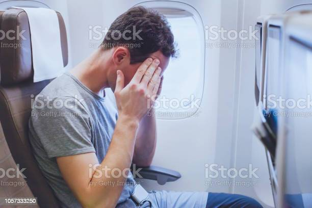 Headache in the airplane man passenger afraid and feeling bad during picture id1057333250?b=1&k=6&m=1057333250&s=612x612&h=3zblvw699k6t0clqek9jqgiulrrzhzosukehkdx8gkm=