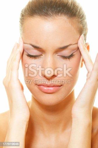 Closeup of young beautiful woman having headache pains
