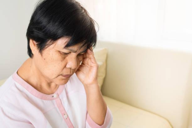 headache, stress, migraine of old woman, healthcare problem of senior concept stock photo