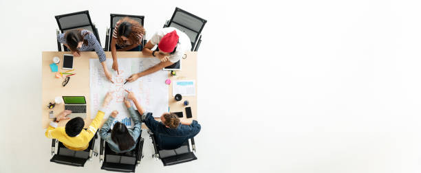 header or banner of top view of creative diverse people. overhead view of young creative team, start up colleagues group or college student meeting and voting agree opinion by pointing hands at desk. - training imagens e fotografias de stock