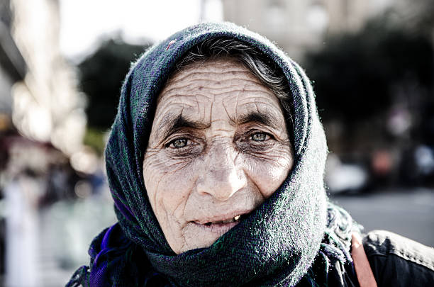 headhot of woman gipsy wearing a scarf on her head - gold tooth stock photos and pictures