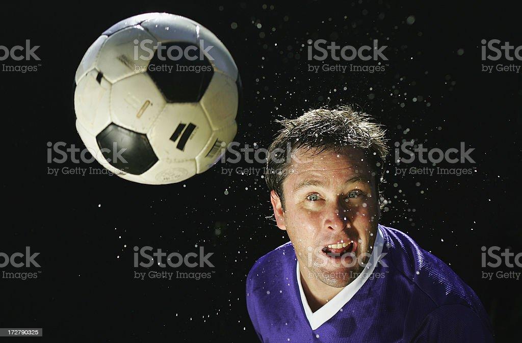 Heading a Football royalty-free stock photo
