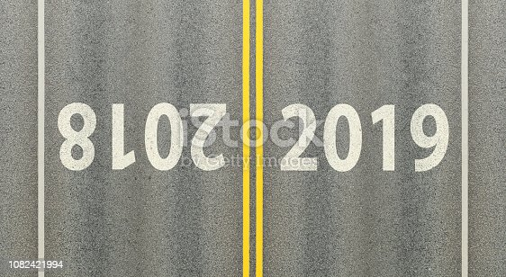 1081330336 istock photo Heading for 2019,  sign, road marking, leaving 2018 1082421994
