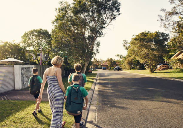 heading home after school - suburban street stock photos and pictures
