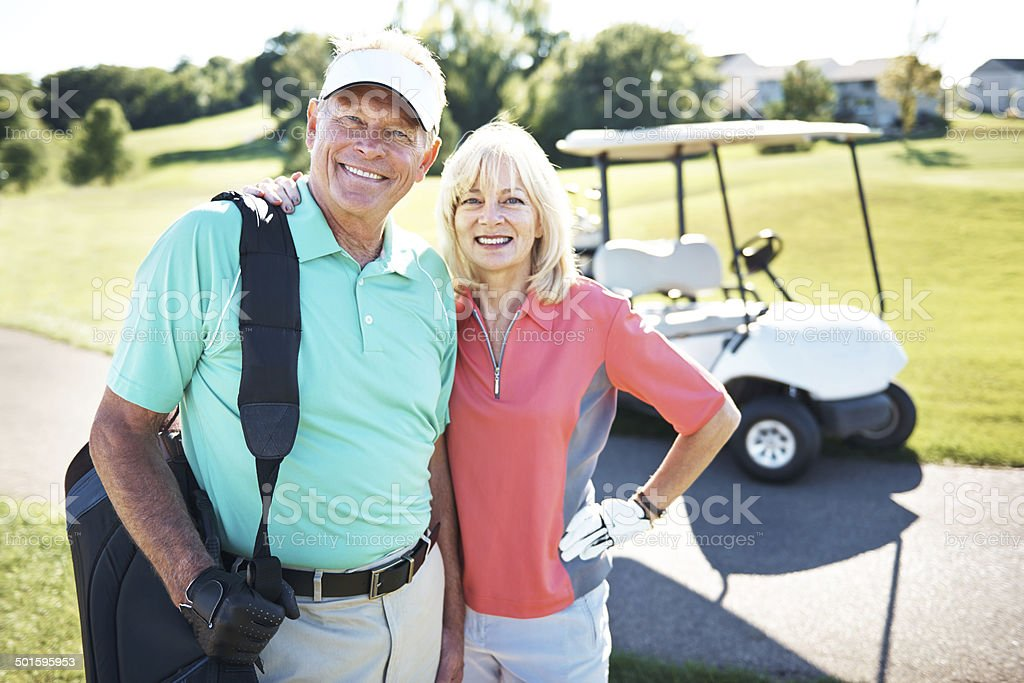 Heading off to the husband-and-wife golf tournament stock photo