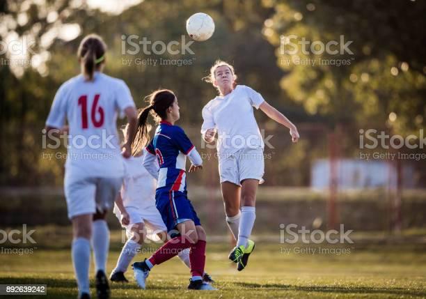 Heading the ball on womens soccer match picture id892639242?b=1&k=6&m=892639242&s=612x612&h=8qwtnz5jlwmn7l7ojv6ata8wiwlollnaxip6p9ynilc=