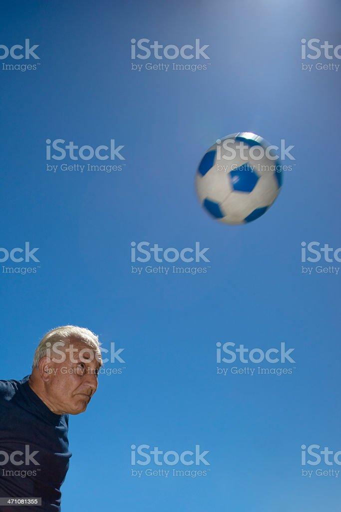 Heading the Soccer Ball, Senior Sportsman royalty-free stock photo