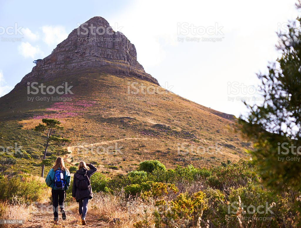 Heading to the top of Lion's Head Rearview shot of two young women hiking on Lion's Head Active Lifestyle Stock Photo