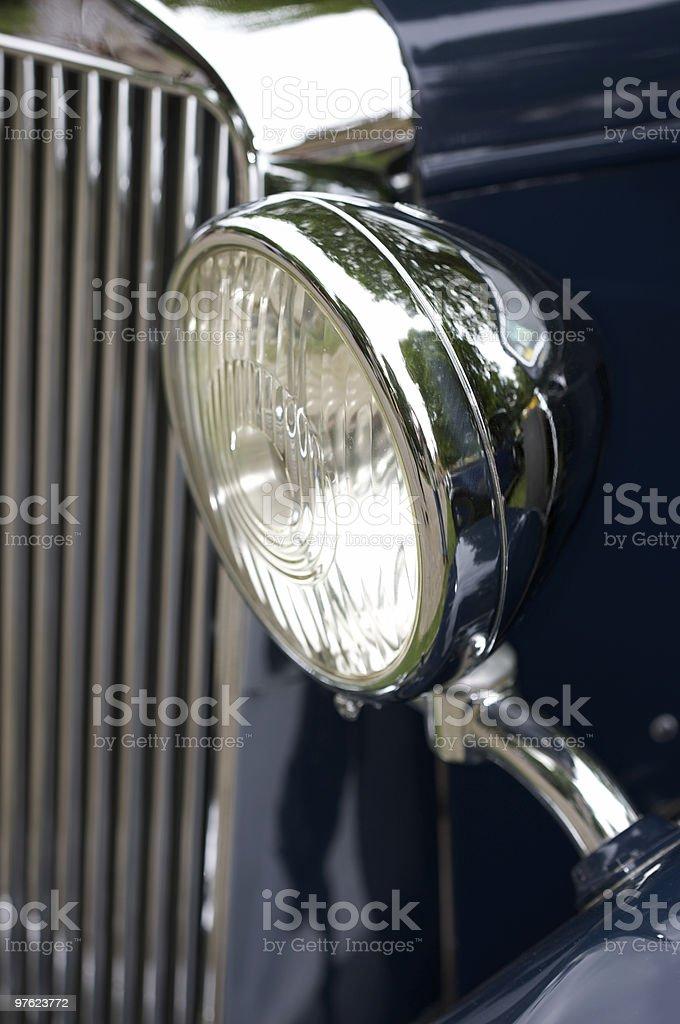 Headlamp on Blue Vintage Car royaltyfri bildbanksbilder