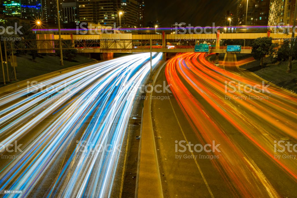 Headlamp trails on the highway stock photo