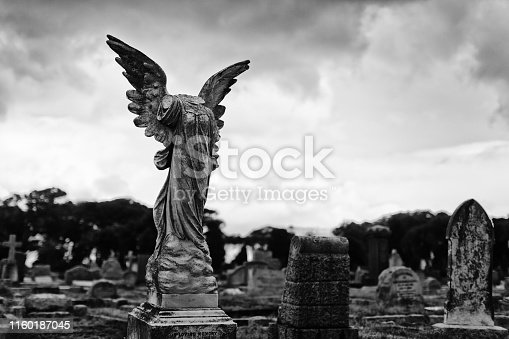 Mutilated angel statue in a cemetery.