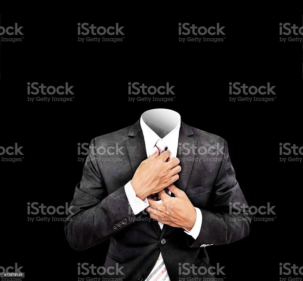 Headless businessman in old antique black suit, isolated stock photo