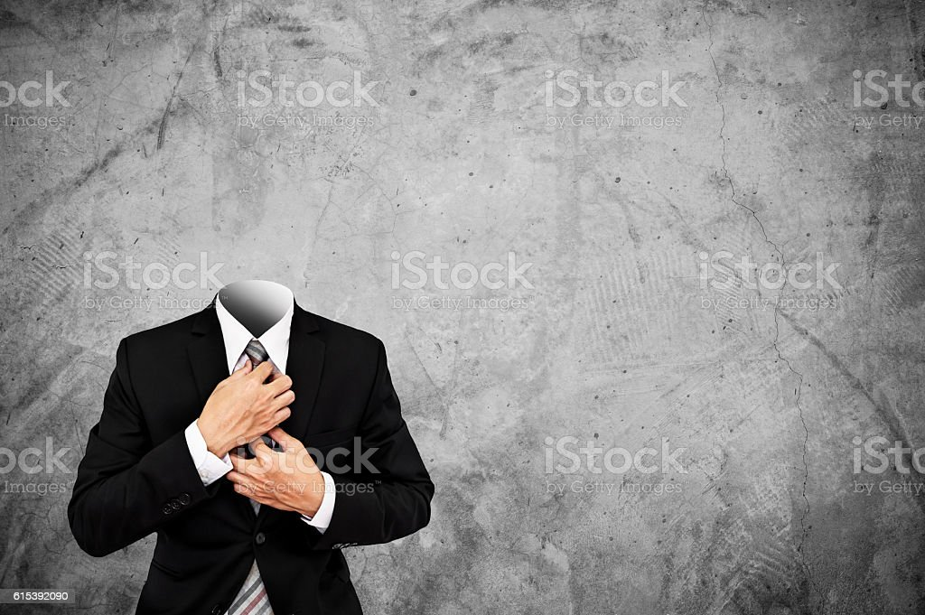 Headless businessman on concrete texture background with copy space stock photo