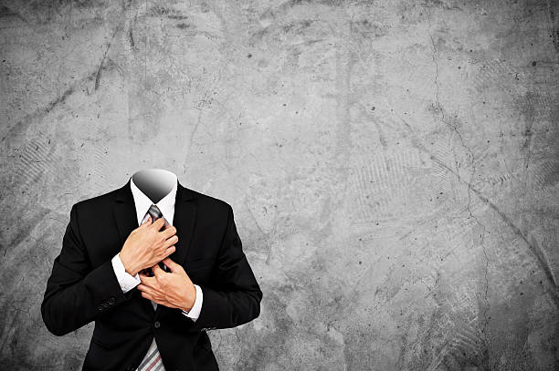 headless businessman on concrete texture background with copy space - 被砍頭 個照片及圖片檔