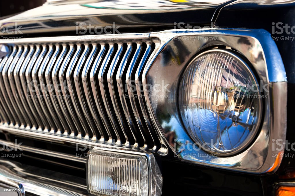 headlight and radiator grille of black retro car royalty-free stock photo