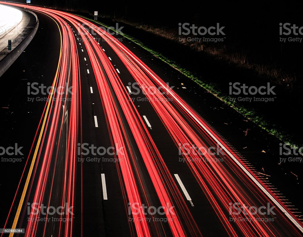 Headlight and taillights of the fast moving vehicle at night stock photo
