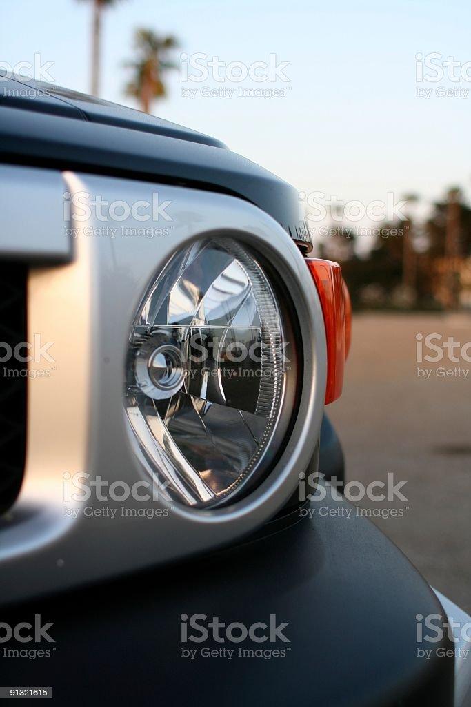 SUV Headlight at Sunset stock photo