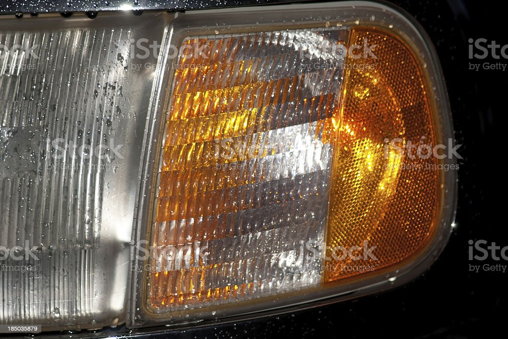 headlight by rain with water splash royalty-free stock photo