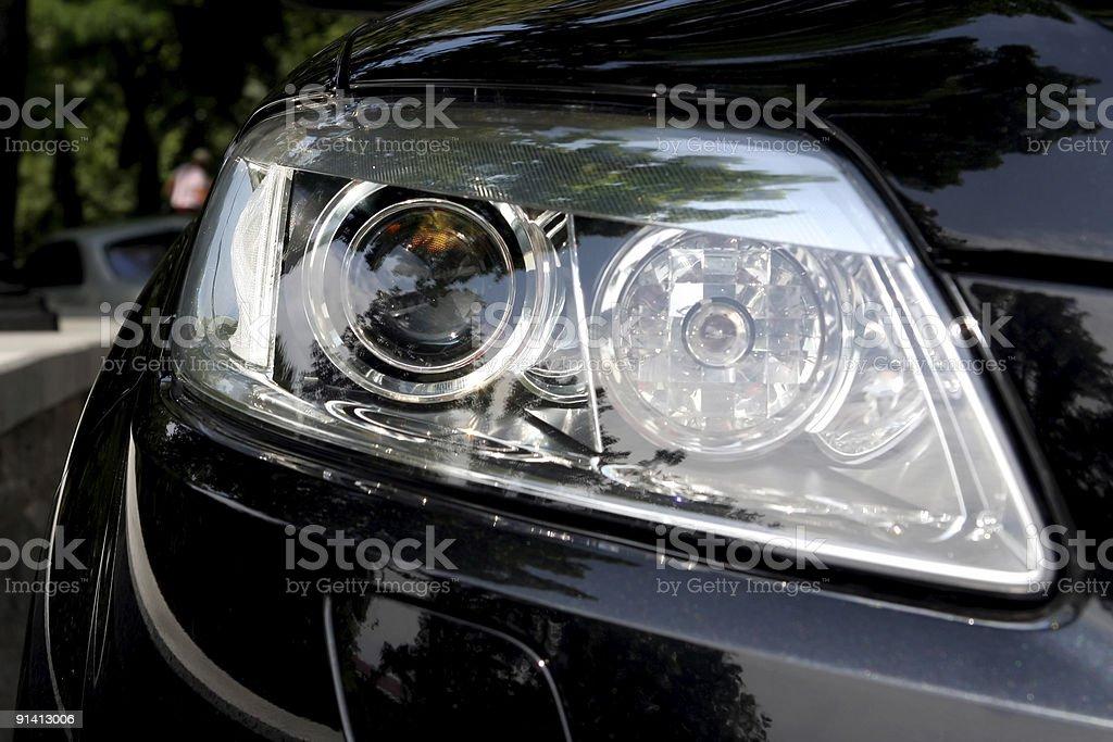 Headlight of a black car stock photo