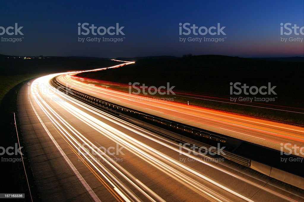 Headlights and Taillights on Motorway at Night, Long Time Exposure - Royaltyfri Abstrakt Bildbanksbilder