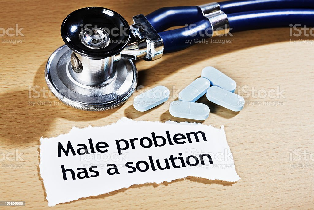 Headline claiming solution to male problem plus stethoscope and medication royalty-free stock photo