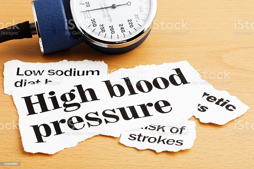 Headlines about high blood pressure with a sphygmomanometer royalty-free stock photo