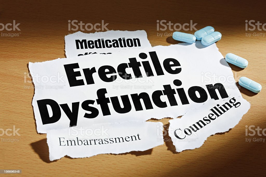 Headlines on erectile dysfunction, embarrassment, counselling, plus some blue pills royalty-free stock photo