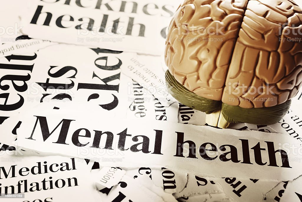 Headlines on mental health issues with model brain royalty-free stock photo