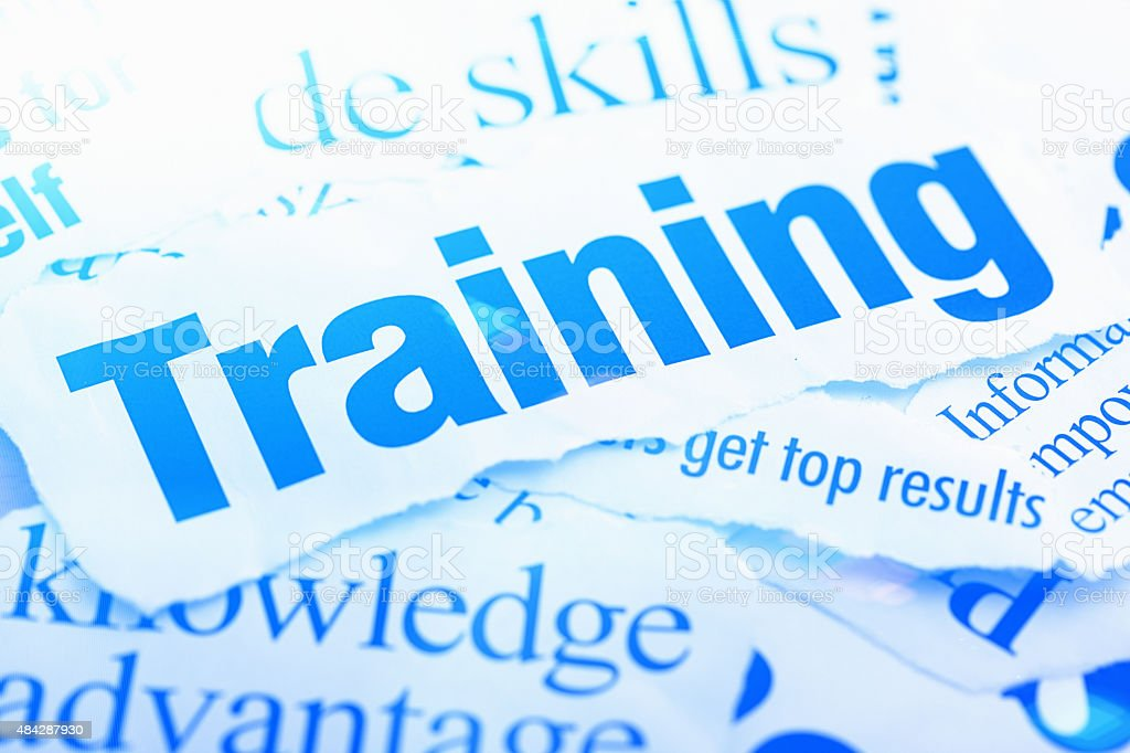 Headlines on the value of training and knowledge. Blue toned. stock photo