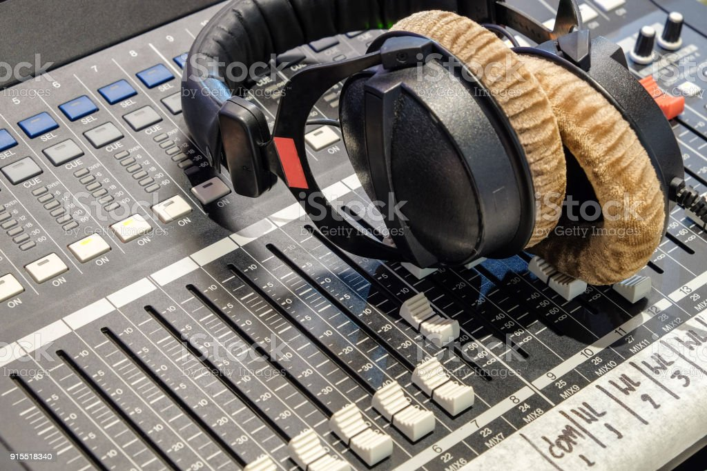 Headphone and audio controller stock photo
