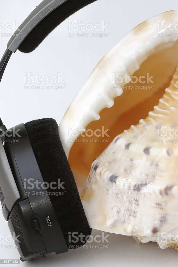 Headphone and seaschell royalty-free stock photo