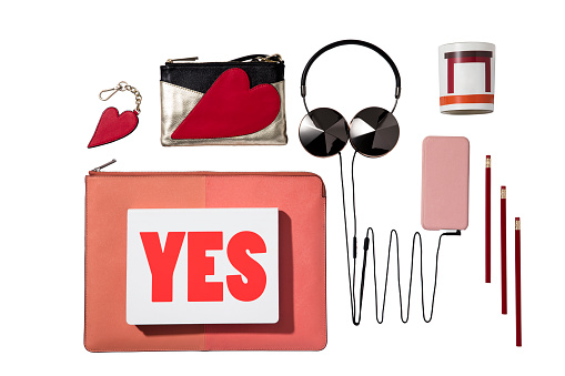 Headphone, heart shaped bag,  cellphone with pens isolated on white background(with clipping path)