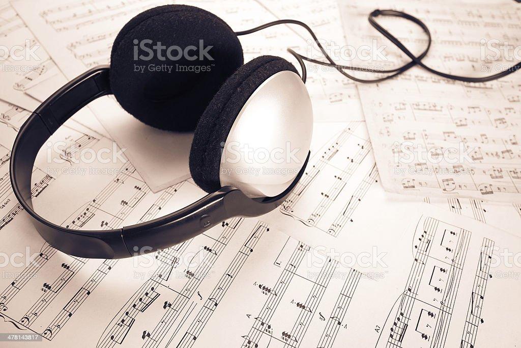 headphone on music sheet stock photo