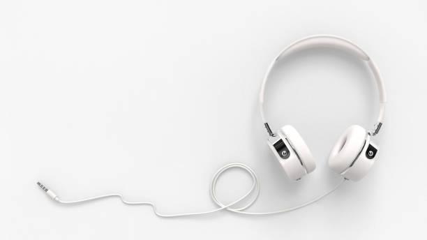 headphone on paper white background with clipping path - słuchawka nauszna zdjęcia i obrazy z banku zdjęć