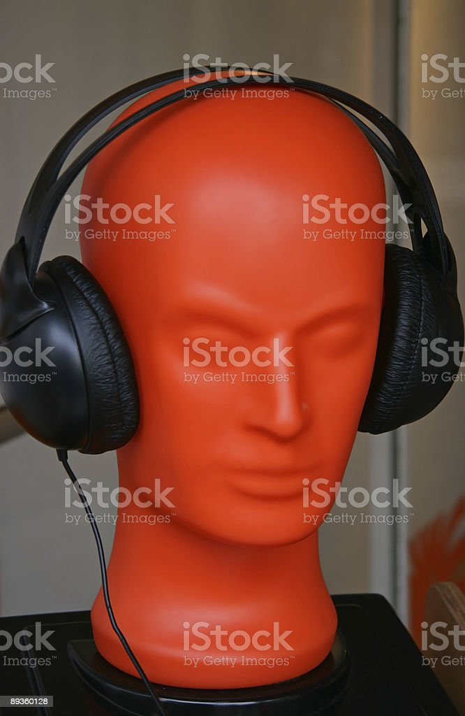 Headphone on red head royalty free stockfoto
