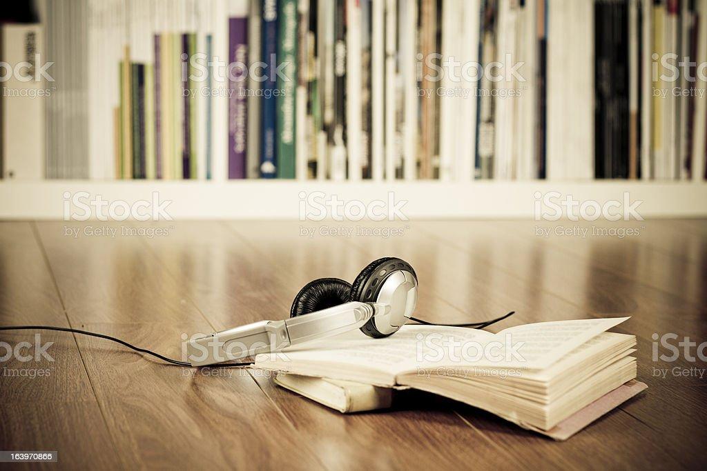 Headphones & books stock photo