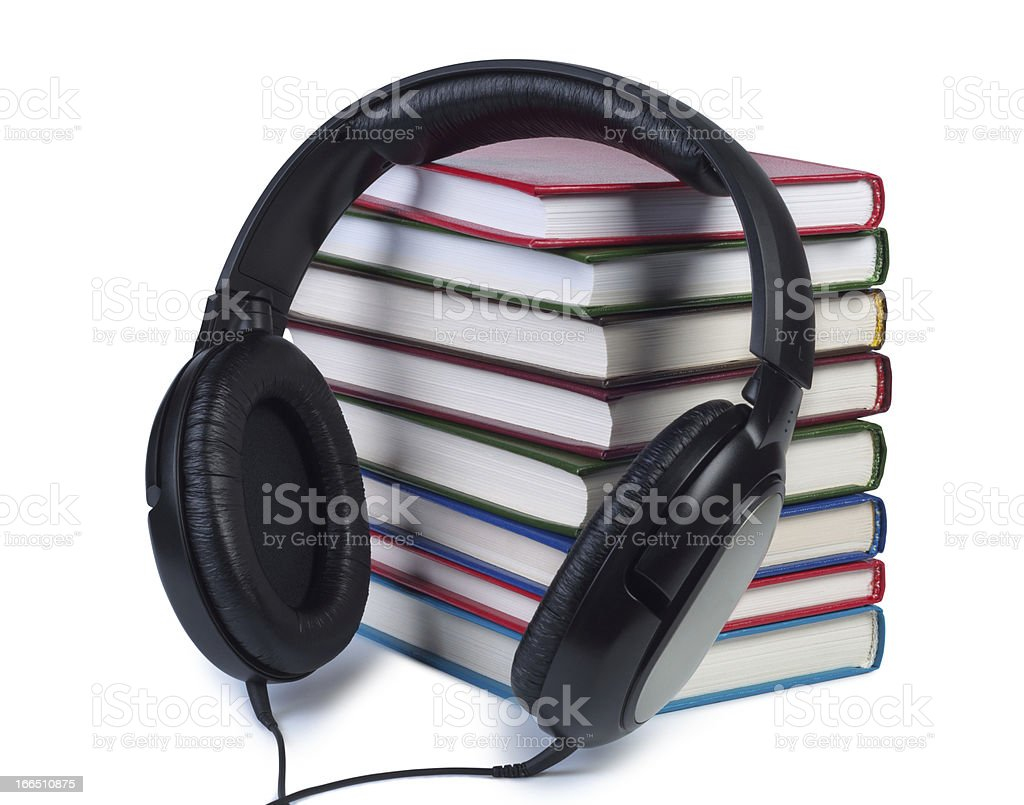 Headphones and a stack of books. royalty-free stock photo