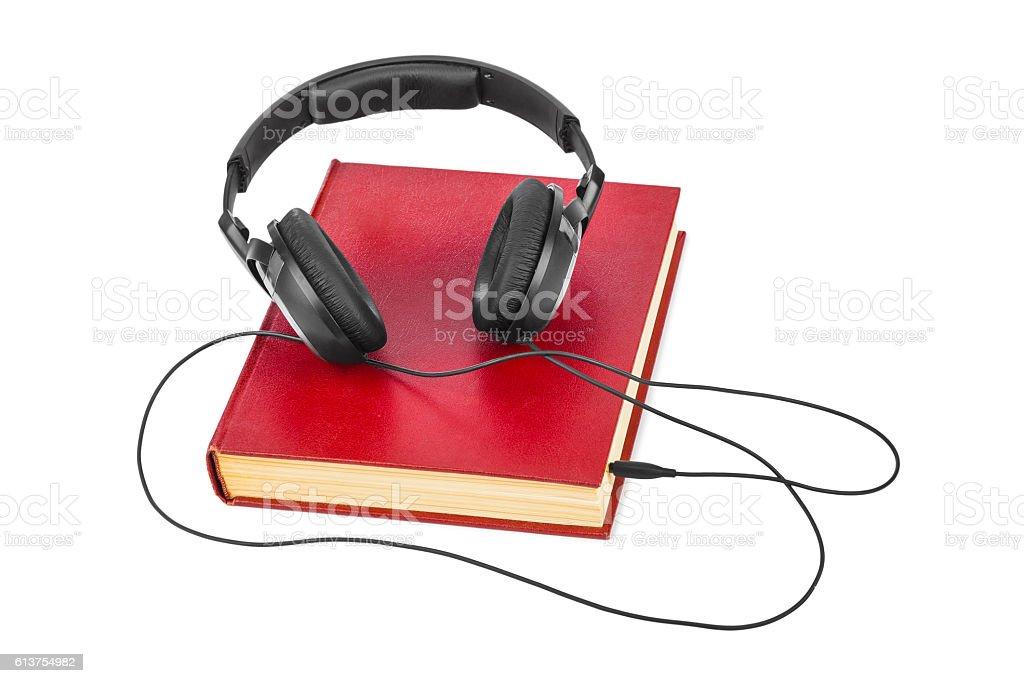 Headphones and book stock photo