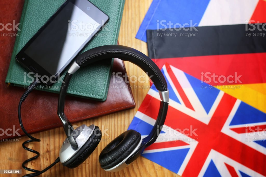 headphones and flag on a wooden background ストックフォト
