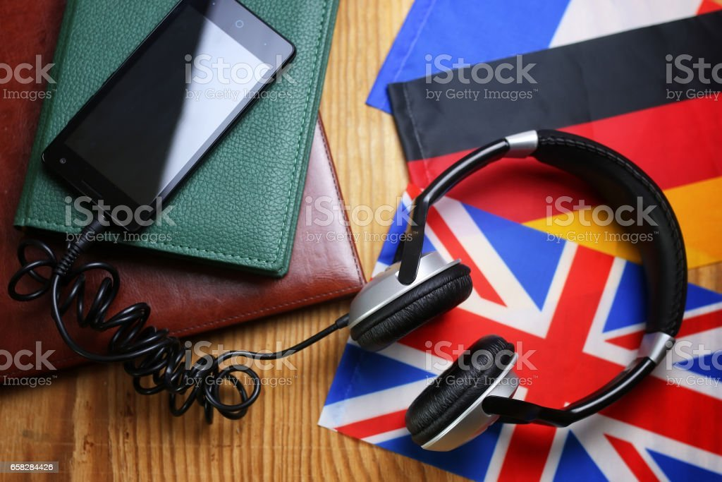 headphones and flag on a wooden background - Photo