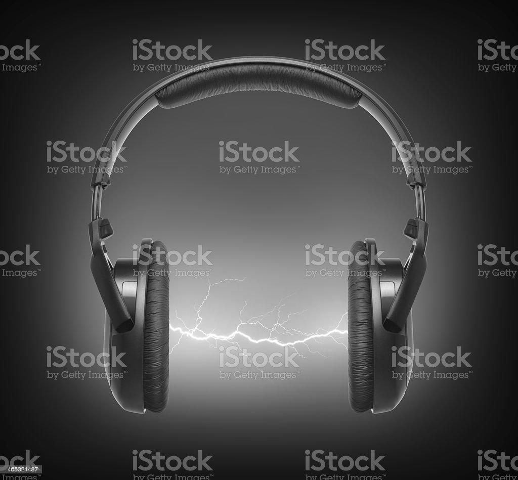 Headphones and lightning stock photo