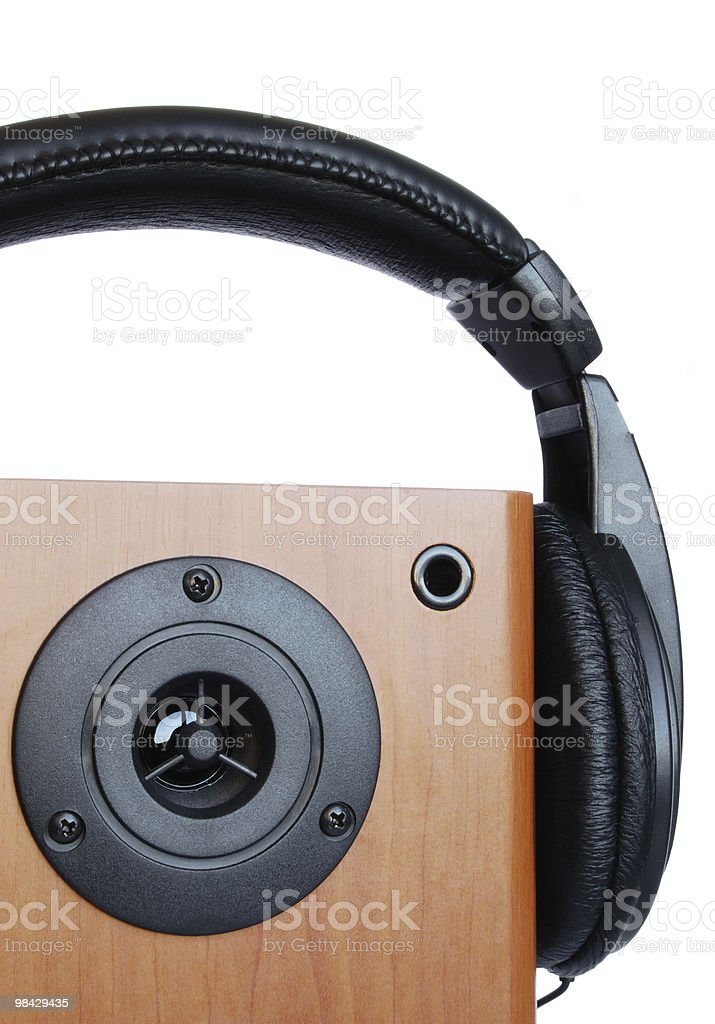 headphones and loud speaker on a white background royalty-free stock photo