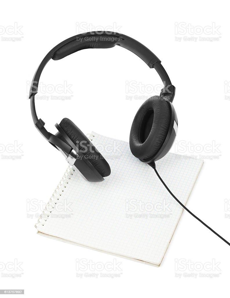 Headphones and notepad stock photo