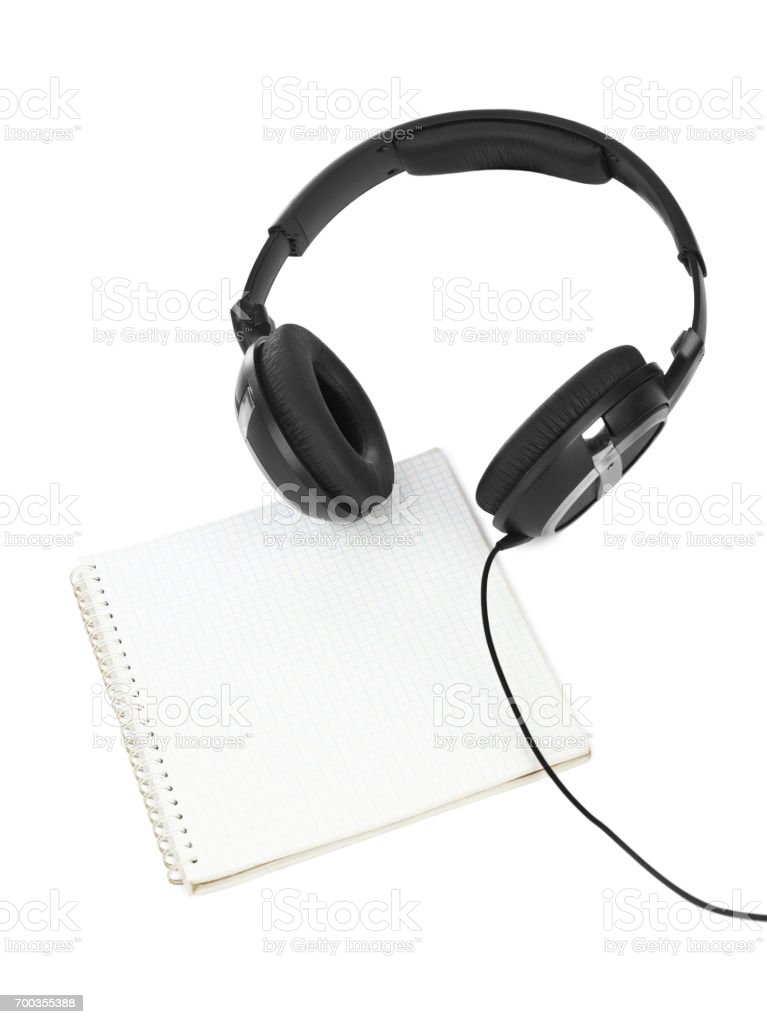 Headphones and notepad stock photo