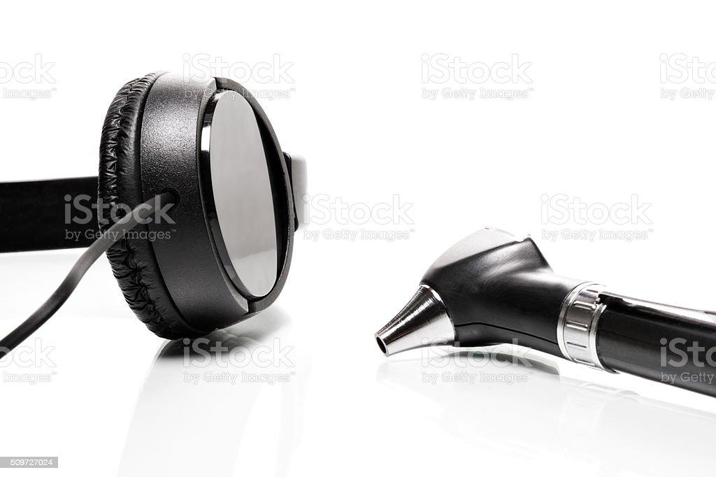 Headphones and Otoscope stock photo